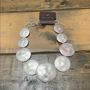 Limited silver statement necklace.